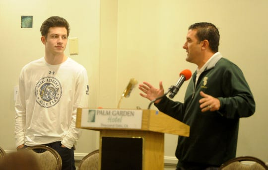 St. Bonaventure head coach Tony Henney introduces Kai Rojas, left, during the Ventura County coaches' annual signing day banquet at the Palm Garden Hotel in Newbury Park on Wednesday. Rojas is headed to the U.S. Naval Academy.
