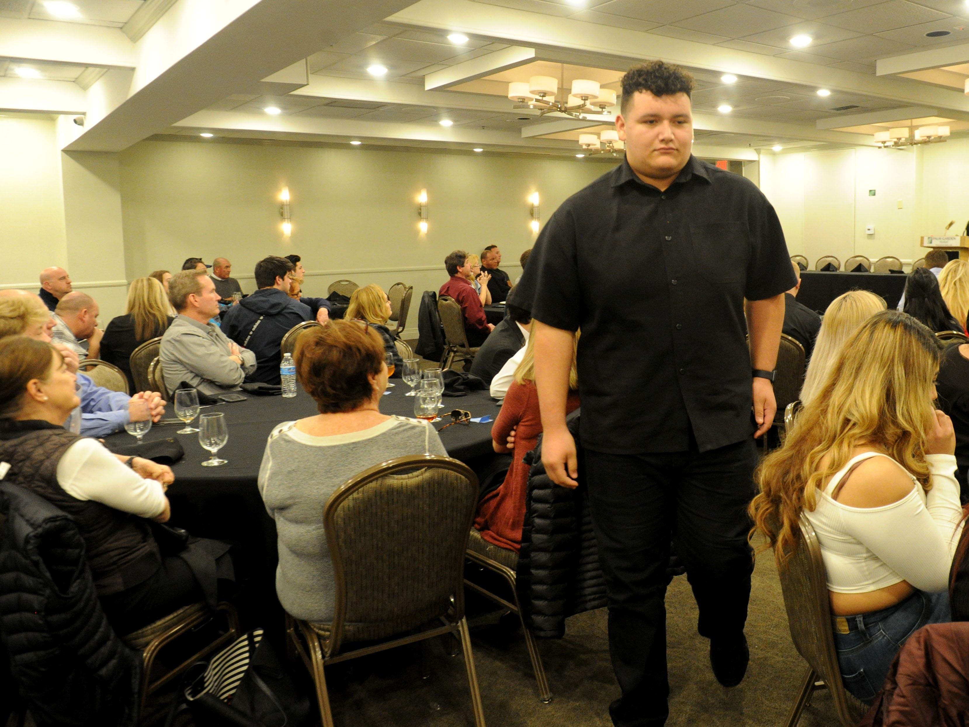 Pacifica High's Armando Sifuentes goes to his table after speaking about his future at Azusa Pacific University during the Ventura County coaches' annual signing day banquet at the Palm Garden Hotel in Newbury Park on Wednesday.