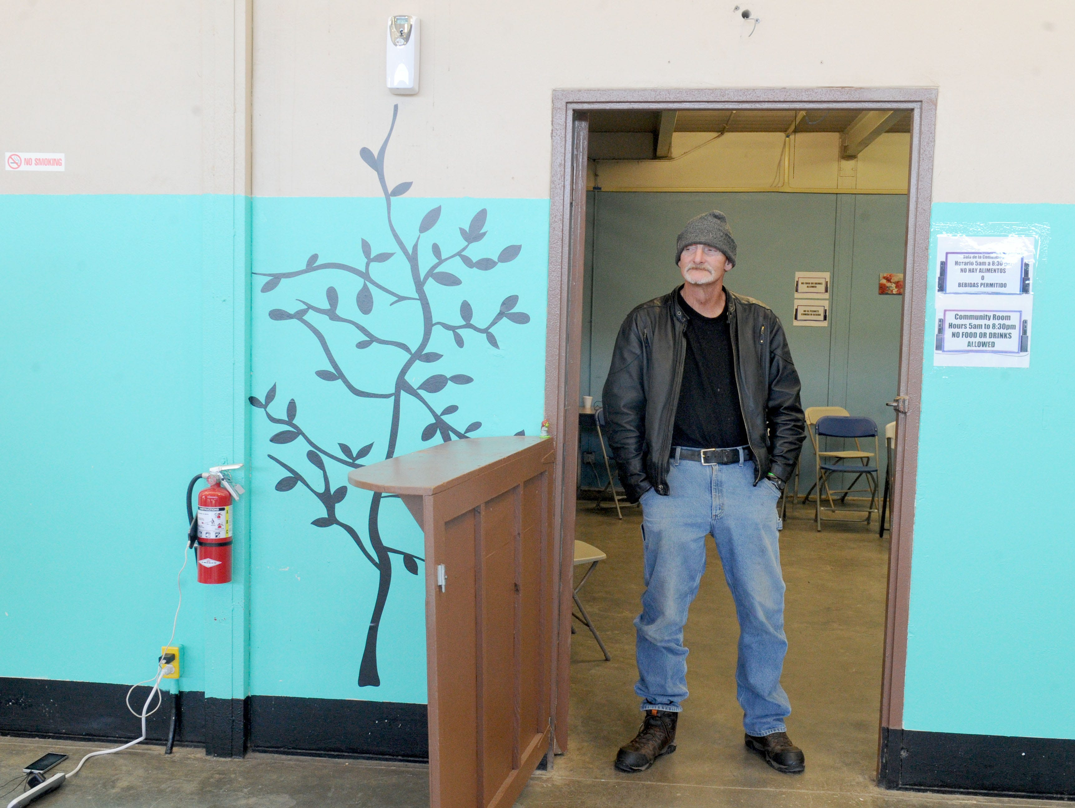 Scott Stebbings takes a break from watching television at the Oxnard homeless shelter.