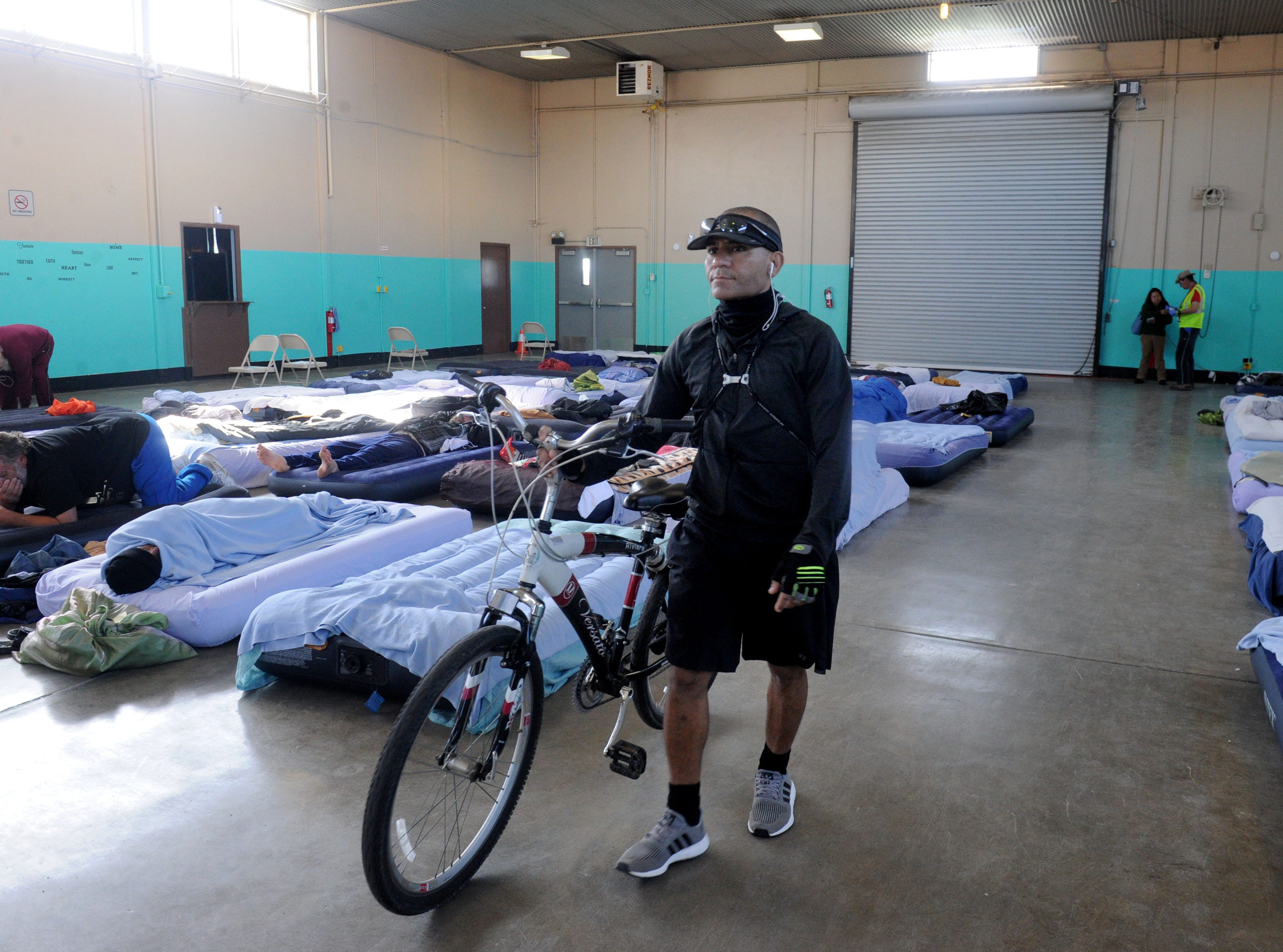 Samuel Foster gets ready to leave the Oxnard homeless shelter to run errands.