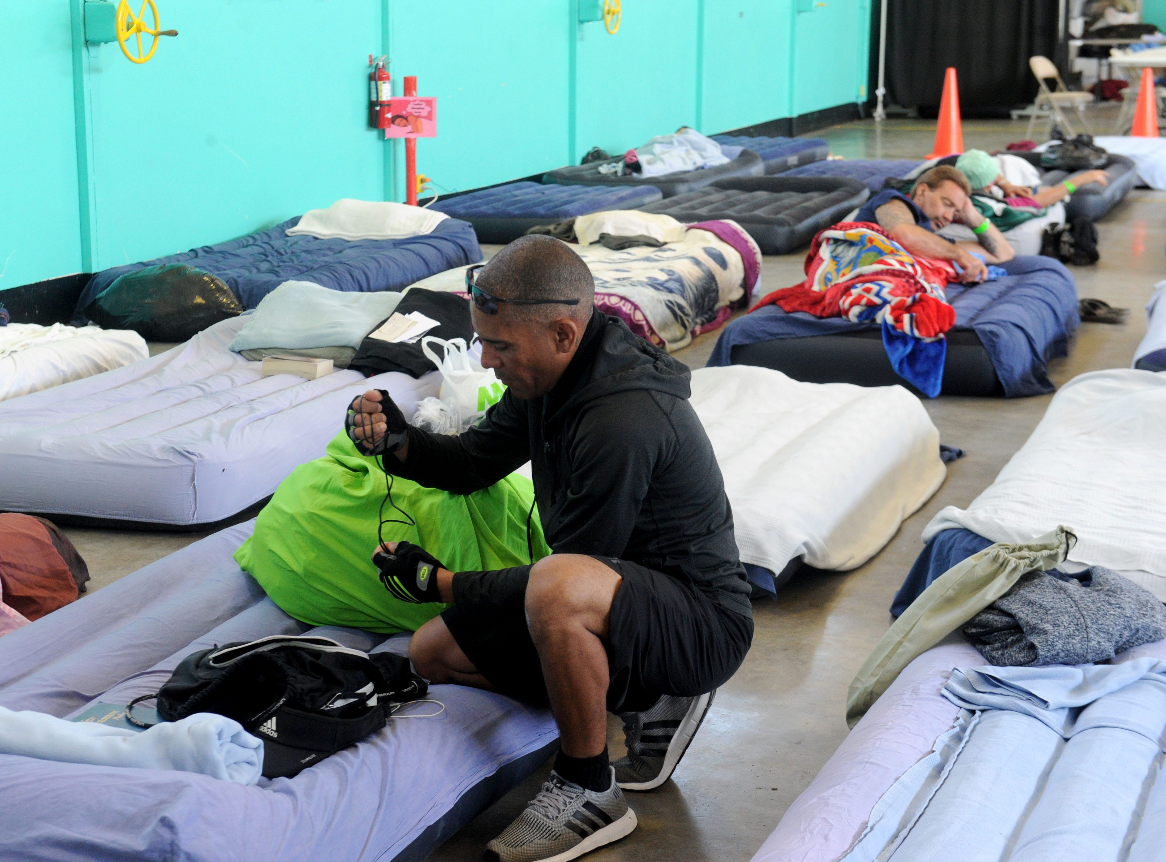 Samuel Foster gets ready to leave the Oxnard homeless shelter to run errands. This is the first year for the the west county shelter to be open 24 hours a day.