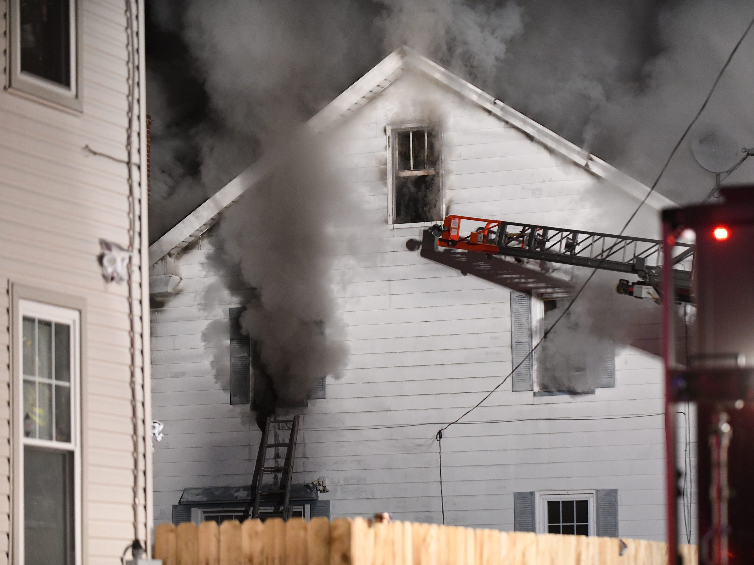 Firefighters in Millville battle a house blaze that ripped through a East Sassafras Street dwelling on Tuesday, Feb. 5, 2019.