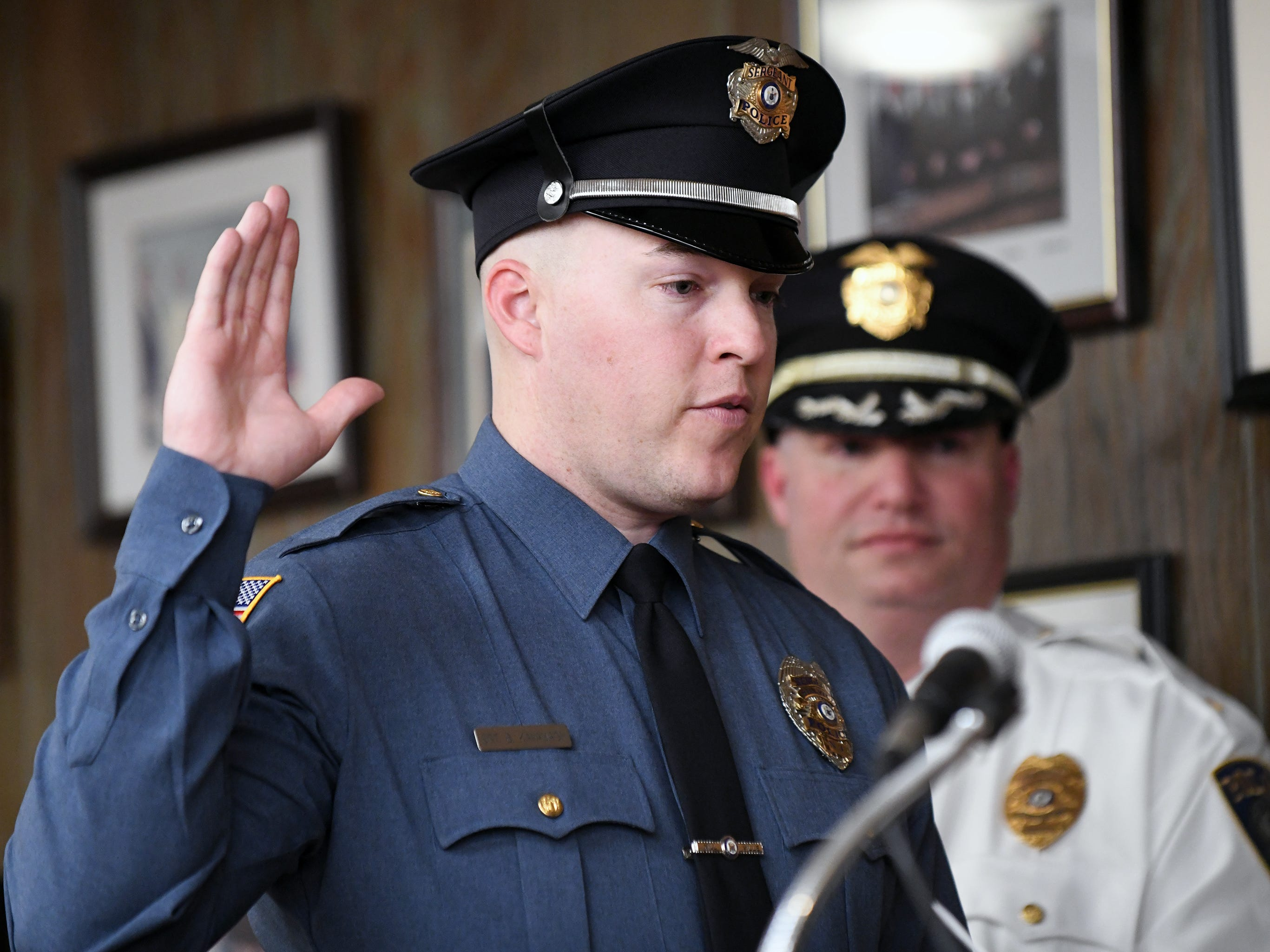Millville Police Officer Brandon O. Kavanagh is promoted to Sgt. during Tuesday night's City Commission meeting.