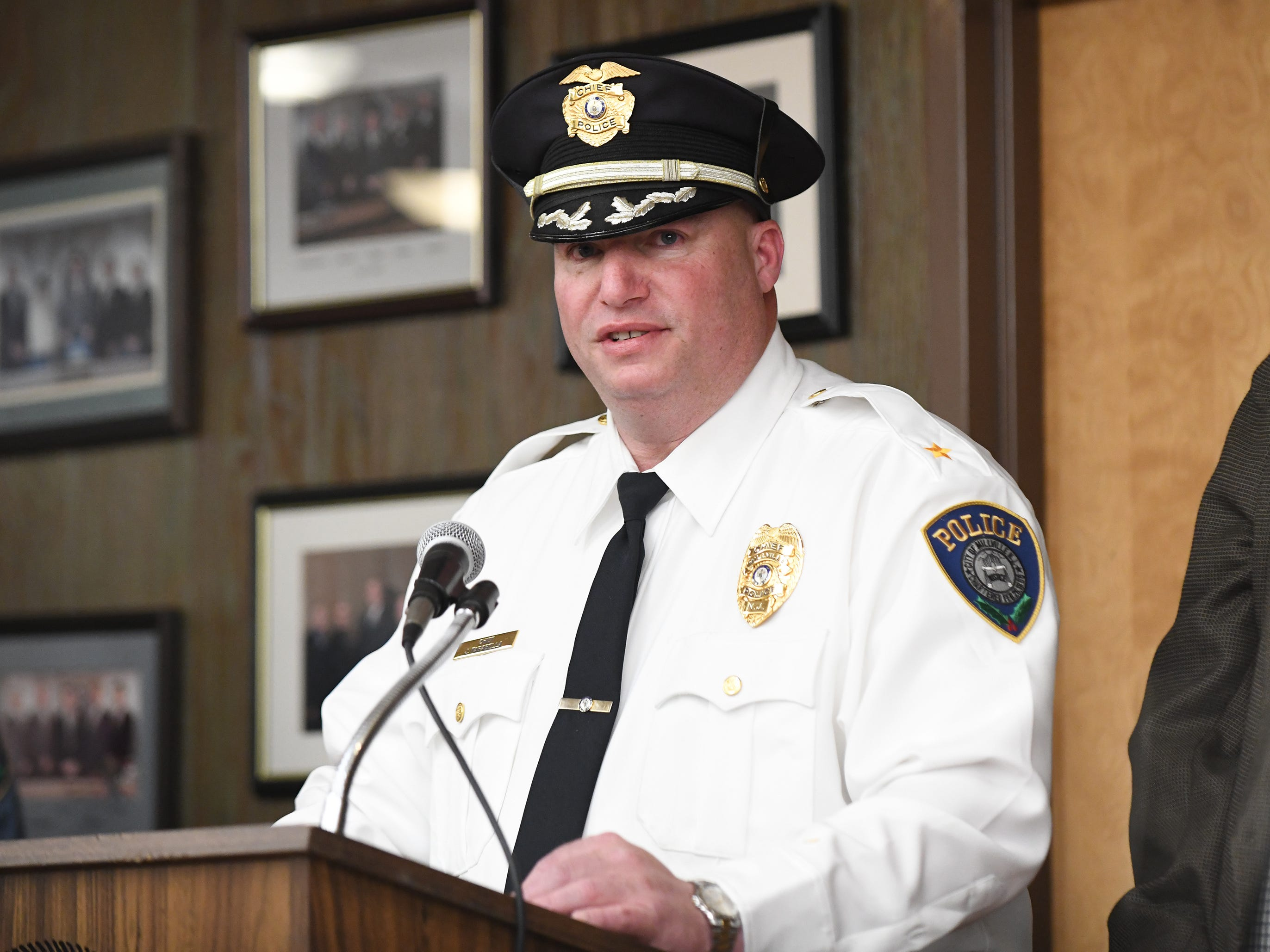 Millville Police Chief Jody Farabella speaks about Lt. Lawrence J. Mulford, regarding his retirement, at Tuesday night's City Commission meeting.