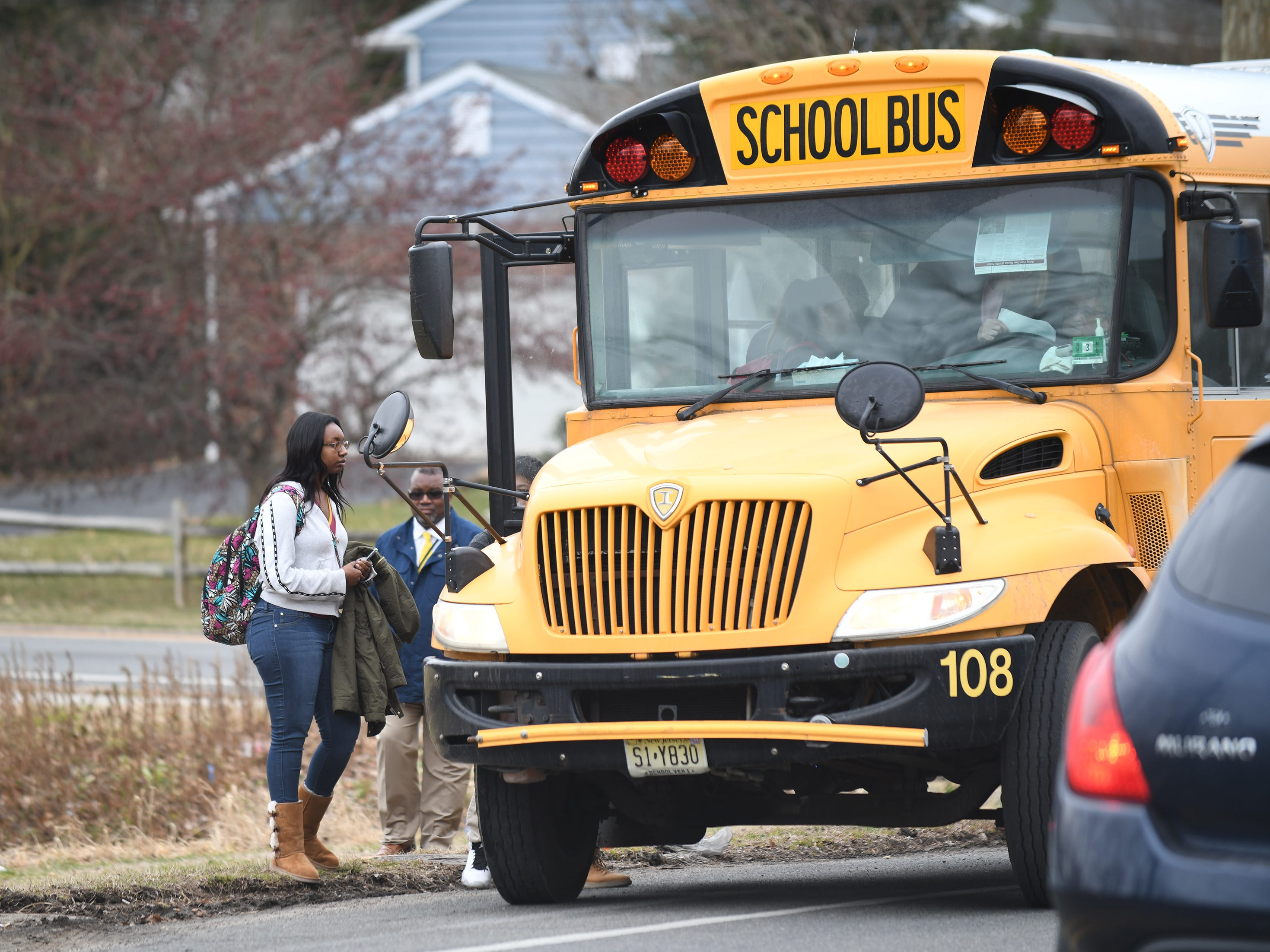 Students board a second bus after their first bus was involved in a collision at the corner of Landis and Brewster in Vineland on Wednesday, Feb. 6, 2019.