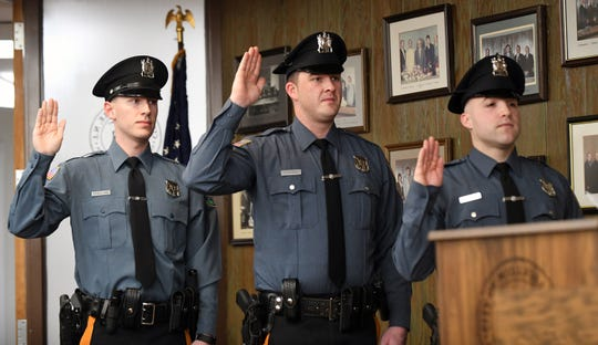 From left to right, Joseph Fogg, Tyler Place and Louis Torres III are sworn in as the latest Millville police officers during Tuesday night's City Commission meeting.