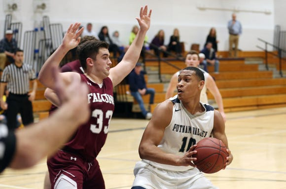 Putnam Valley's Daniel Shillingford (10) drives to the basket in front of Albertus Magnus' Steven Travaglini (33) during basketball action at Putnam Valley High School Feb. 5,  2019. Putnam Valley won the game 46-45.