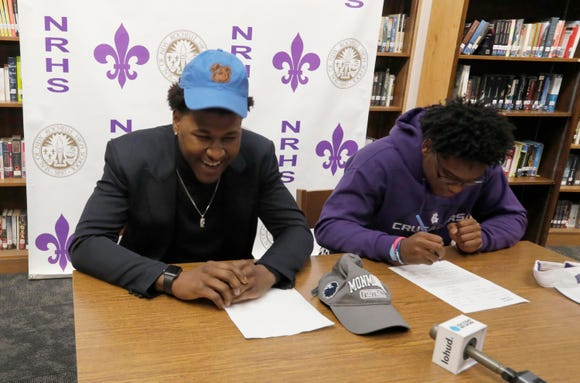 New Rochelle High School football players Khairi Manns and Jordan Forrest sign letters of intent to attend Division 1 schools during National Signing Day for football recruits Feb. 6, 2019. Manns will be attending and playing football at the University of Maine. Forrest will be playing for and attending Holy Cross.