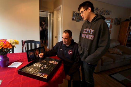 James Cancro of Cortlandt Manor and his son, Jimmy, 20, photographed Feb. 5, 2019, look at patches James collected from his years as a member of the Fairview fire department. Both have a genetic kidney disease that causes their kidneys to fail. James, who had to retire early from his job as a firefighter due to his illness, is on dialysis and waiting for a suitable kidney donor in order to get a transplanted organ. Jimmy, whose health is deteriorating due to the illness, had to withdraw from his sophomore year at SUNY New Paltz. He will also need a kidney transplant.