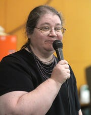 Cathy Russell, the longtime clerk for the East Ramapo school district, speaking during a 2012 meeting. ( Peter Carr / The Journal News )