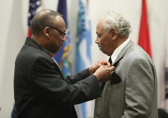 Robert Ellison, left, the 2018 awardee, pins the award on Lewis Green, 72, from Spring Valley, with the Buffalo Soldier Award during a ceremony at Rockland Community College in Suffern on Wednesday, February 6, 2019.