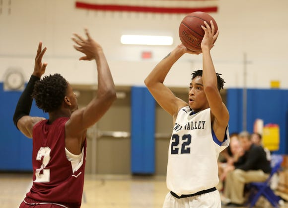Putnam Valley's Brandon Guerra (22) puts up a shot in front of Albertus Magnus' Joseph Jaaron (2) during basketball action at Putnam Valley High School Feb. 5,  2019. Putnam Valley won the game 46-45.