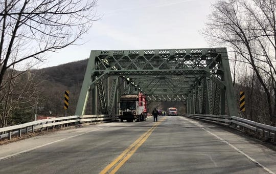 A garbage truck crashed into a metal structure on Route 59 that serves as a bridge over railroad tracks in Hillburn on Feb. 6, 2019.