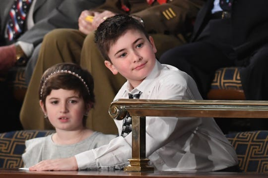 Special guest Joshua Trump (right), a Delaware sixth-grader, attends the State of the Union address at the U.S. Capitol in Washington on Feb. 5, 2019.