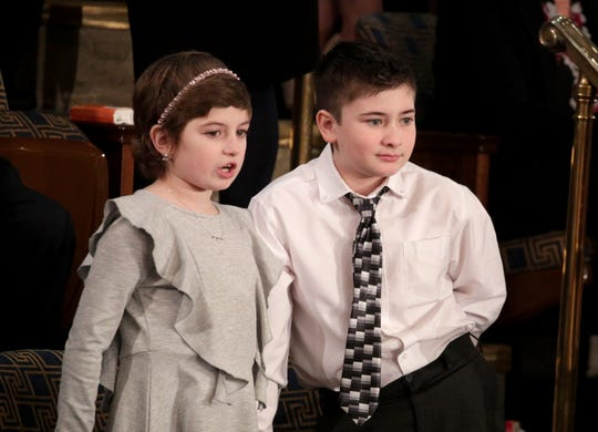 WASHINGTON, DC - FEBRUARY 05:  Grace Eline and Joshua Trump, special guests of President Donald Trump, look on ahead of the State of the Union address in the chamber of the U.S. House of Representatives on February 5, 2019 in Washington, DC. President Trump's second State of the Union address was postponed one week due to the partial government shutdown.  (Photo by Alex Wong/Getty Images)