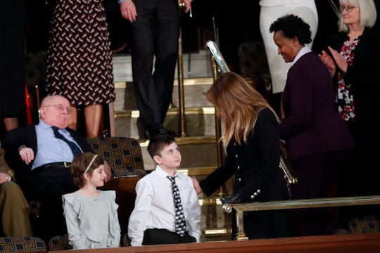 Grace Eline and Joshua Trump greet first lady Melania Trump before President Donald Trump delivers his State of the Union address to a joint session of Congress on Capitol Hill in Washington, Tuesday, Feb. 5, 2019.
