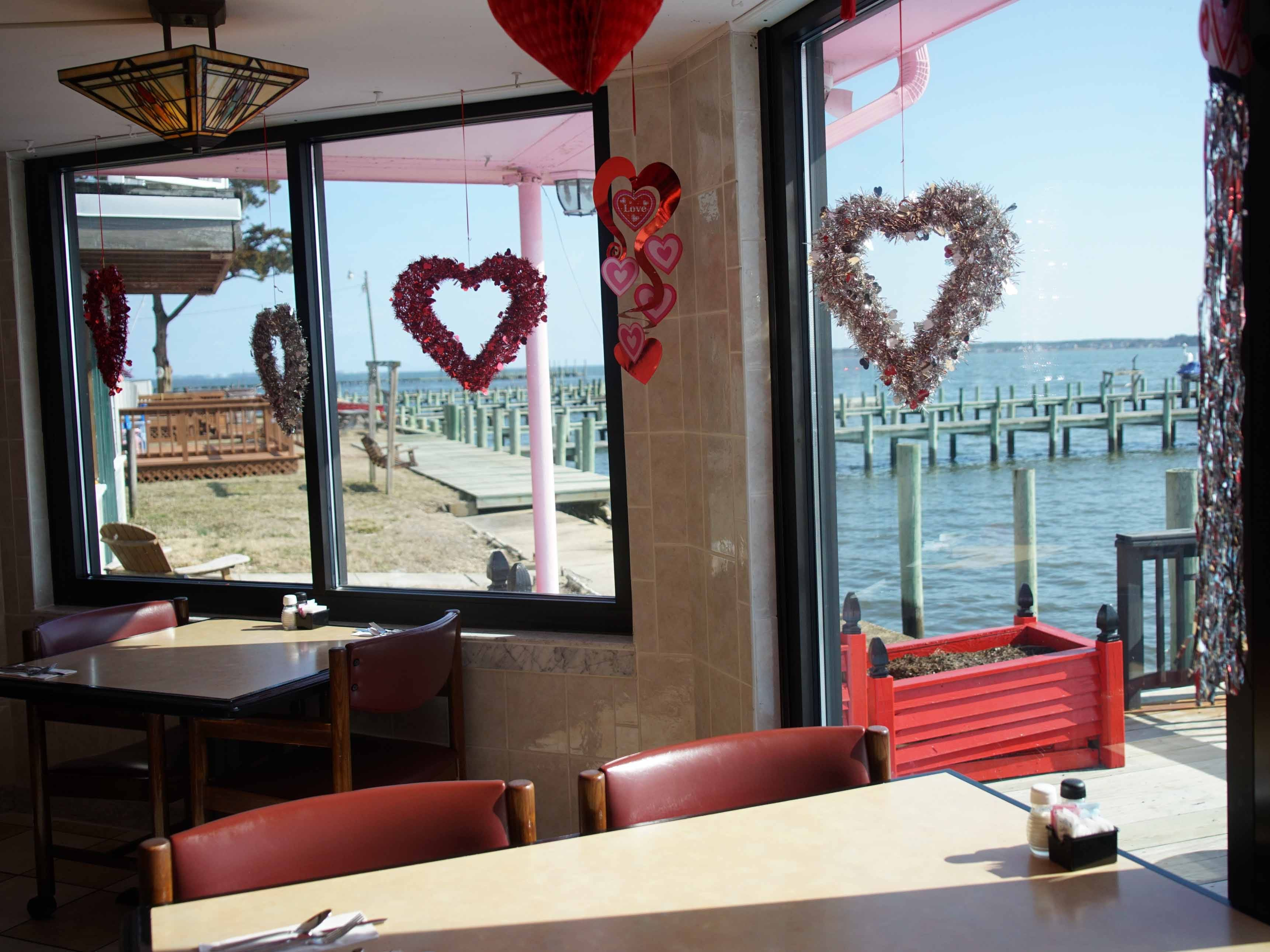 A heart hangs in the window of Serendipity Restaurant in Oak Orchard that overlooks Indian River.