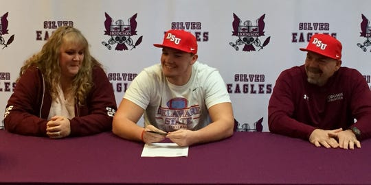 Hodgson's Brandon Shimko and his parents are all smiles after the All-State linebacker signed with Delaware State on Wednesday.