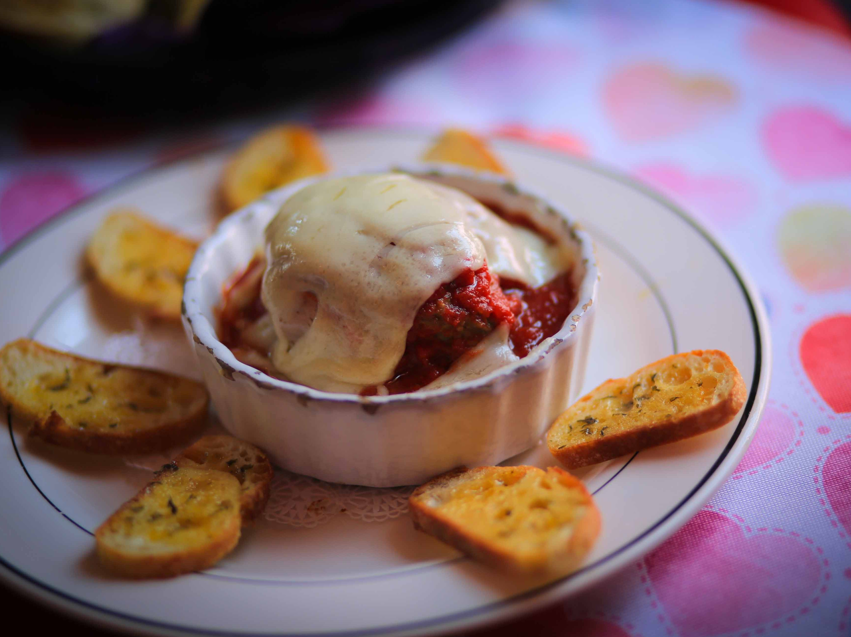 Homemade meatballs with sauce, provolone and mozzaralla at Serendipity Restaurant.