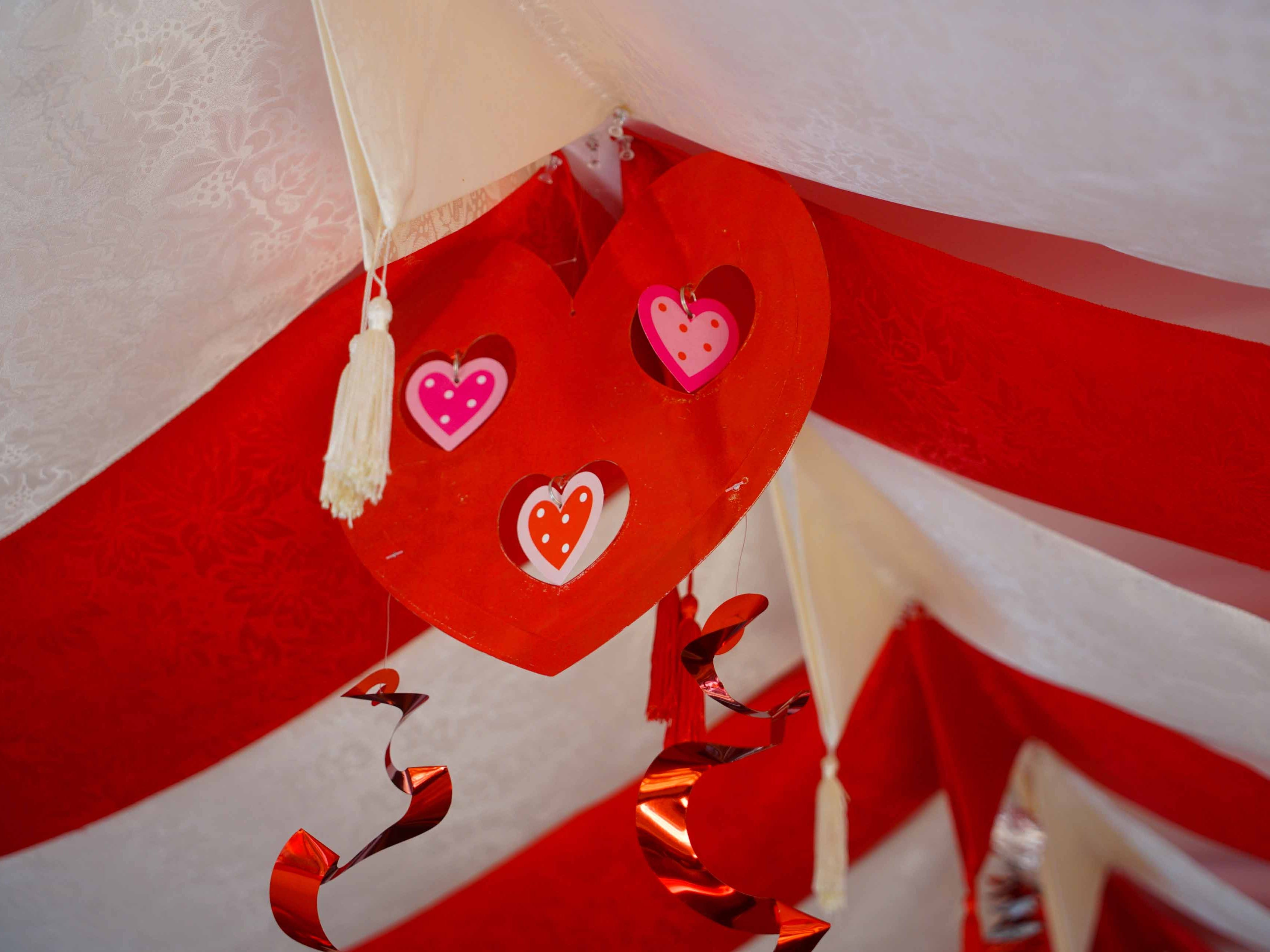 Heart shaped Valentine's Day decor hangs from the ceiling at Serendipity Restaurant.