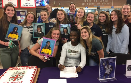 Charter of Wilmington's Sheyenne Allen is surrounded by her soccer teammates after signing to play at Brown University.