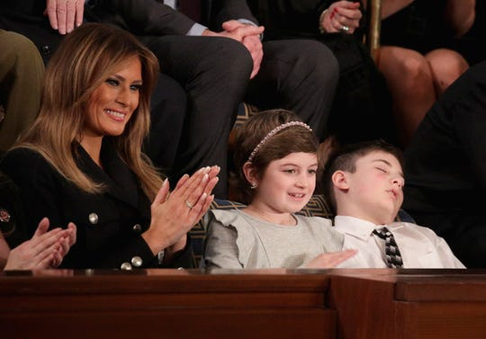 First lady Melania Trump with Grace Eline and Joshua Trump, special guests of President Donald Trump, attend the State of the Union address in the chamber of the U.S. House of Representatives on Feb. 5, 2019 in Washington.