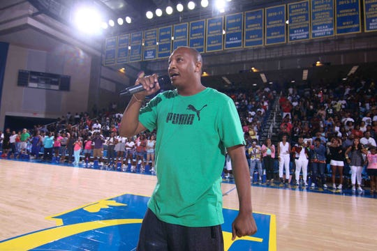 Duffy Samuels addresses the crowd  before the 2015 Duffy's Hope celebrity game at the Carpenter  Center.