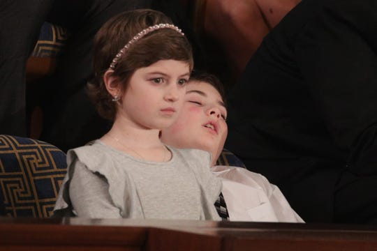 Grace Eline and Joshua Trump, special guests of President Donald Trump, attend the State of the Union address in the chamber of the U.S. House of Representatives on Feb. 5, 2019, in Washington.