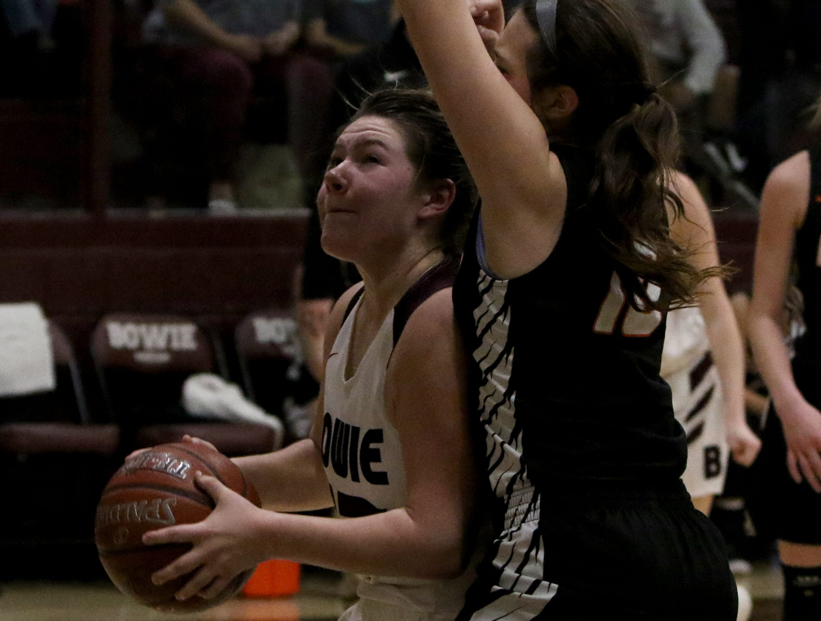 Bowie's Hope Howard looks to the basket by Nocona's Karlee Brown Tuesday, Feb. 5, 2019, in Bowie. Nocona defeated Bowie 38-34.