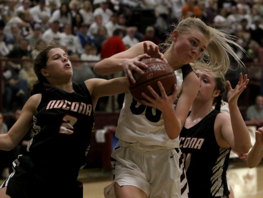 Bowie's Jayci Logan gets the rebound in the game against Nocona Tuesday, Feb. 5, 2019, in Bowie.
