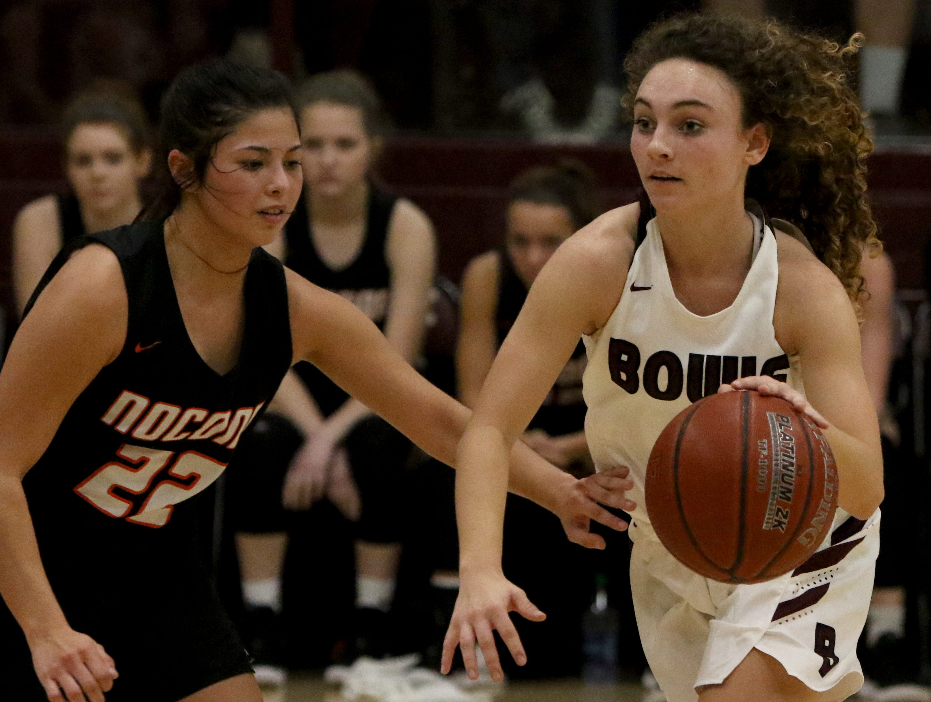 Bowie's Brysen Richey dribbles by Nocona's Brooke O'Neal Tuesday, Feb. 5, 2019, in Bowie. Nocona defeated Bowie 38-34.