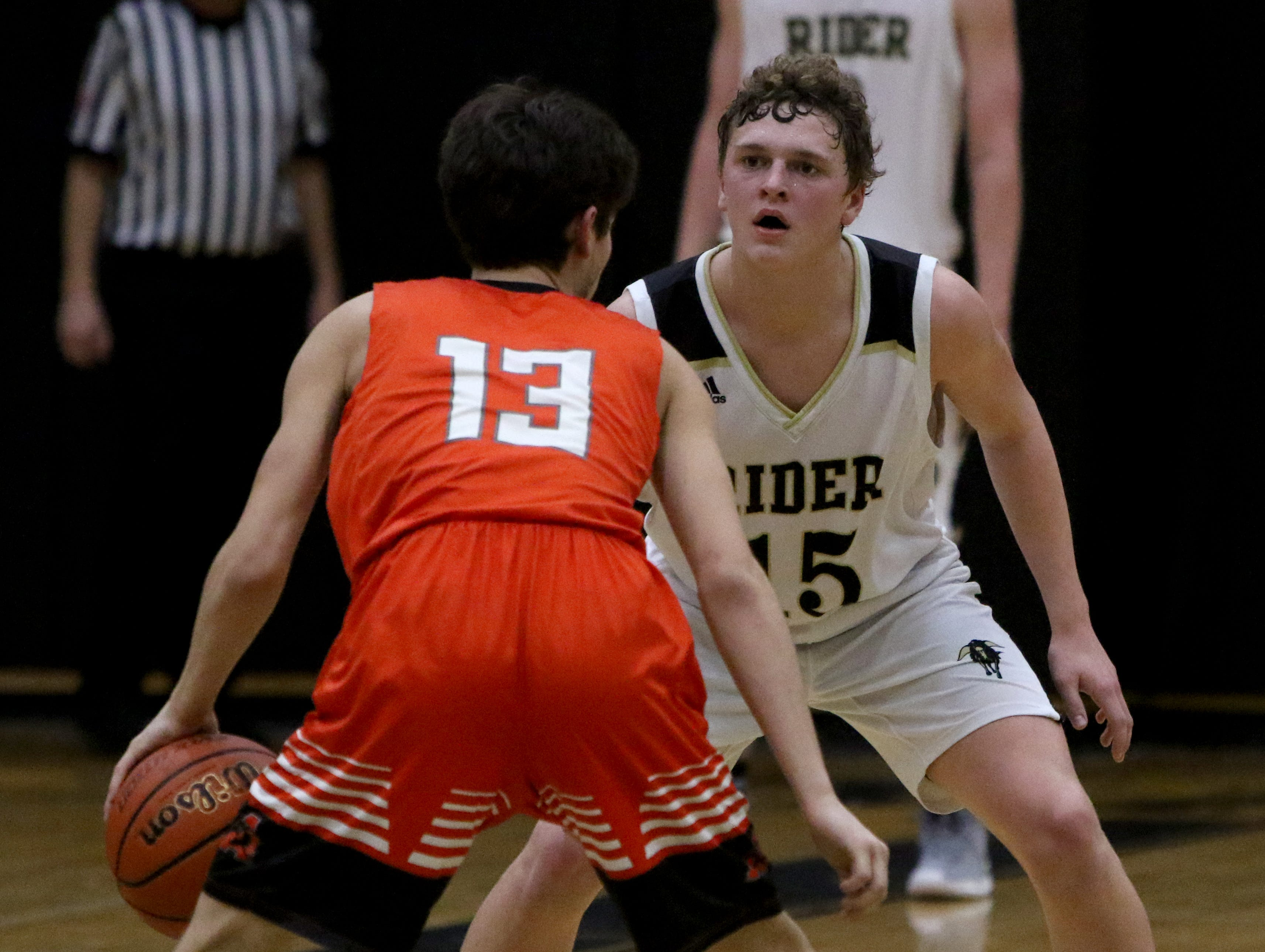 Rider's Carson Sager guards Aledo's Austin Hawkins Tuesday, Feb. 5, 2019, at Rider. The Raiders defeated the Bearcats 64-51.