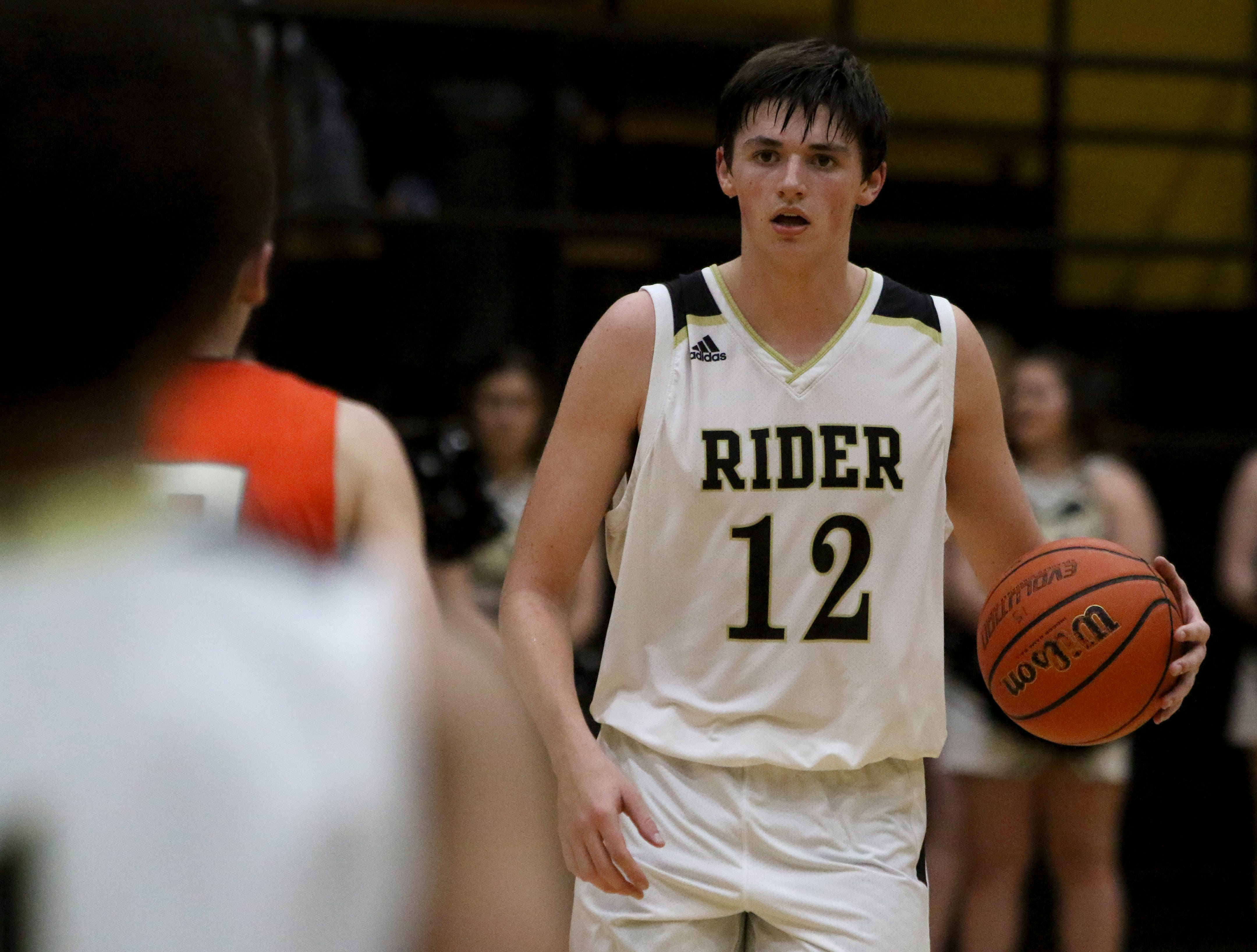 Rider's Ty Caswell dribbles in the game against Aledo Tuesday, Feb. 5, 2019, at Rider. The Raiders defeated the Bearcats 64-51.