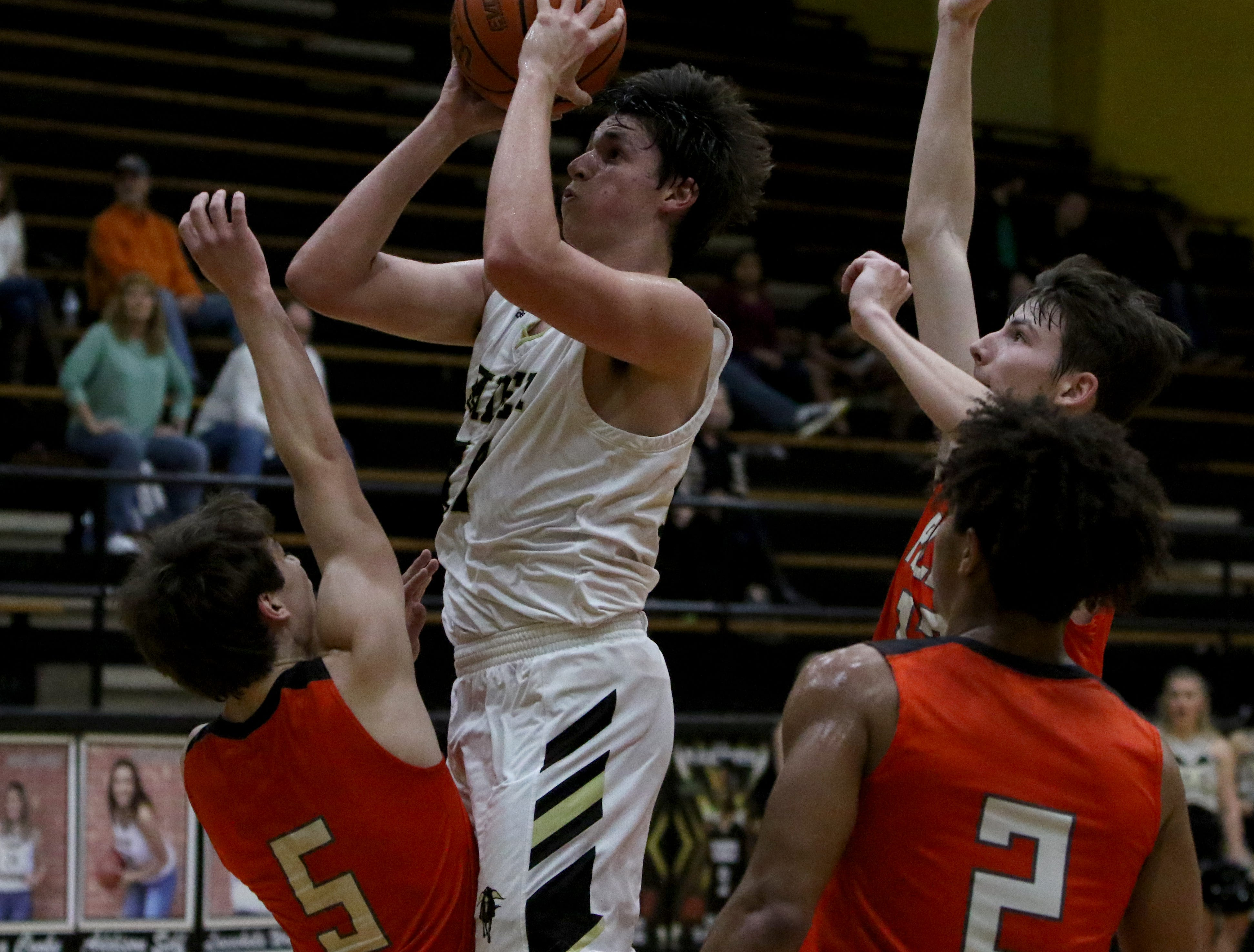 Rider's Ty Caswell goes for a short jumper against Aledo Tuesday, Feb. 5, 2019, at Rider. The Raiders defeated the Bearcats 64-51.