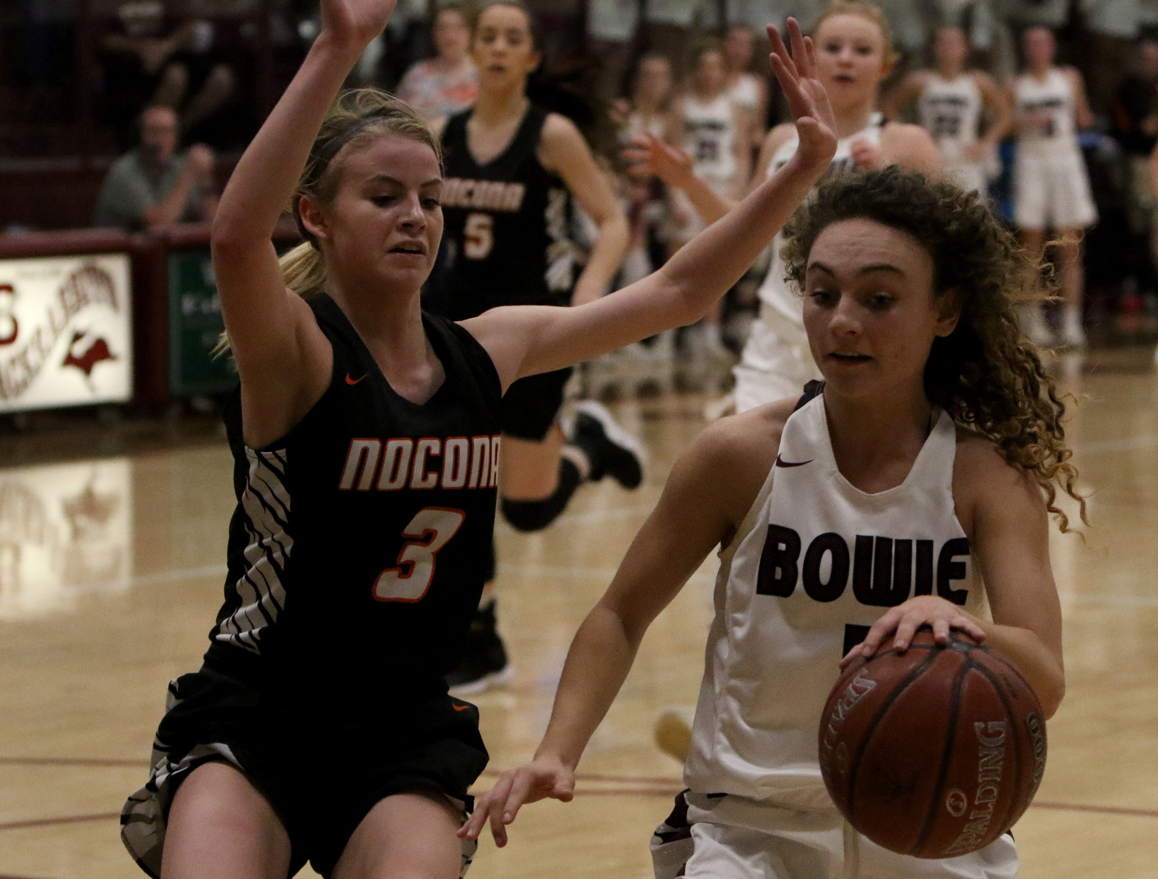 Bowie's Brysen Richey changes direction by Nocona's Chloe Daughtry Tuesday, Feb. 5, 2019, in Bowie. Nocona defeated Bowie 38-34.