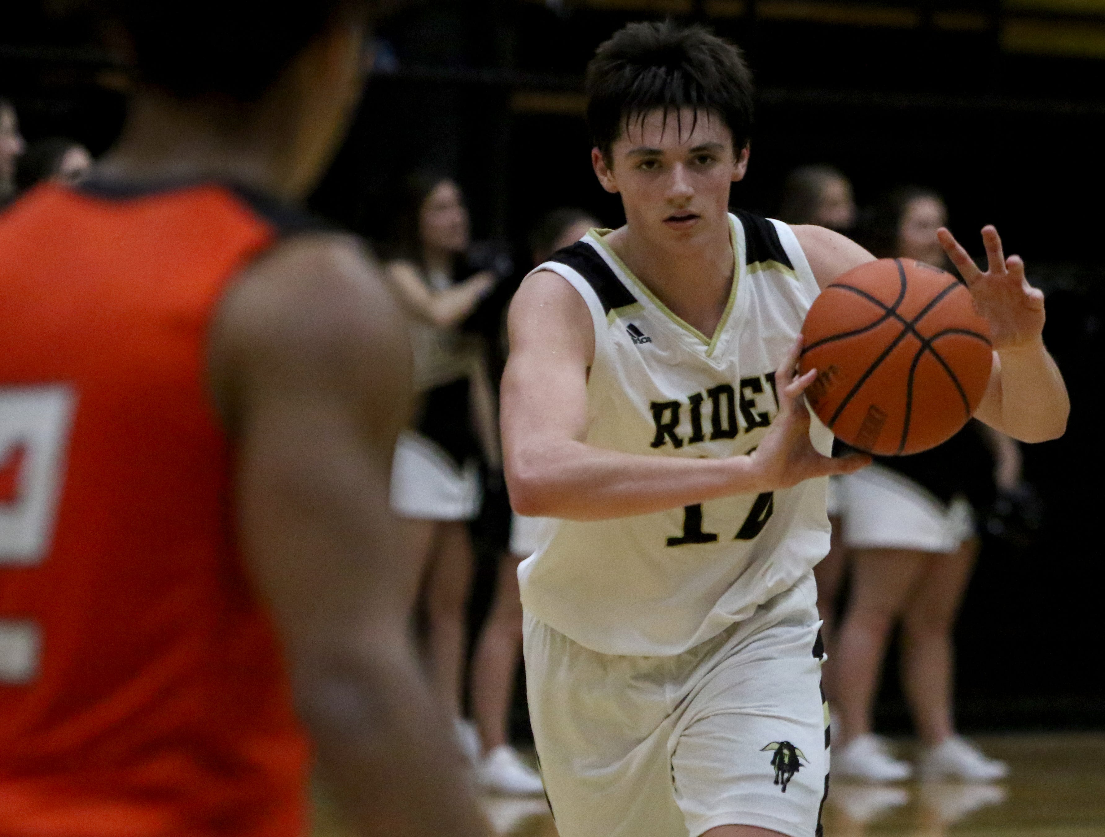 Rider's Ty Caswell passes in the game against Aledo Tuesday, Feb. 5, 2019, at Rider. The Raiders defeated the Bearcats 64-51.