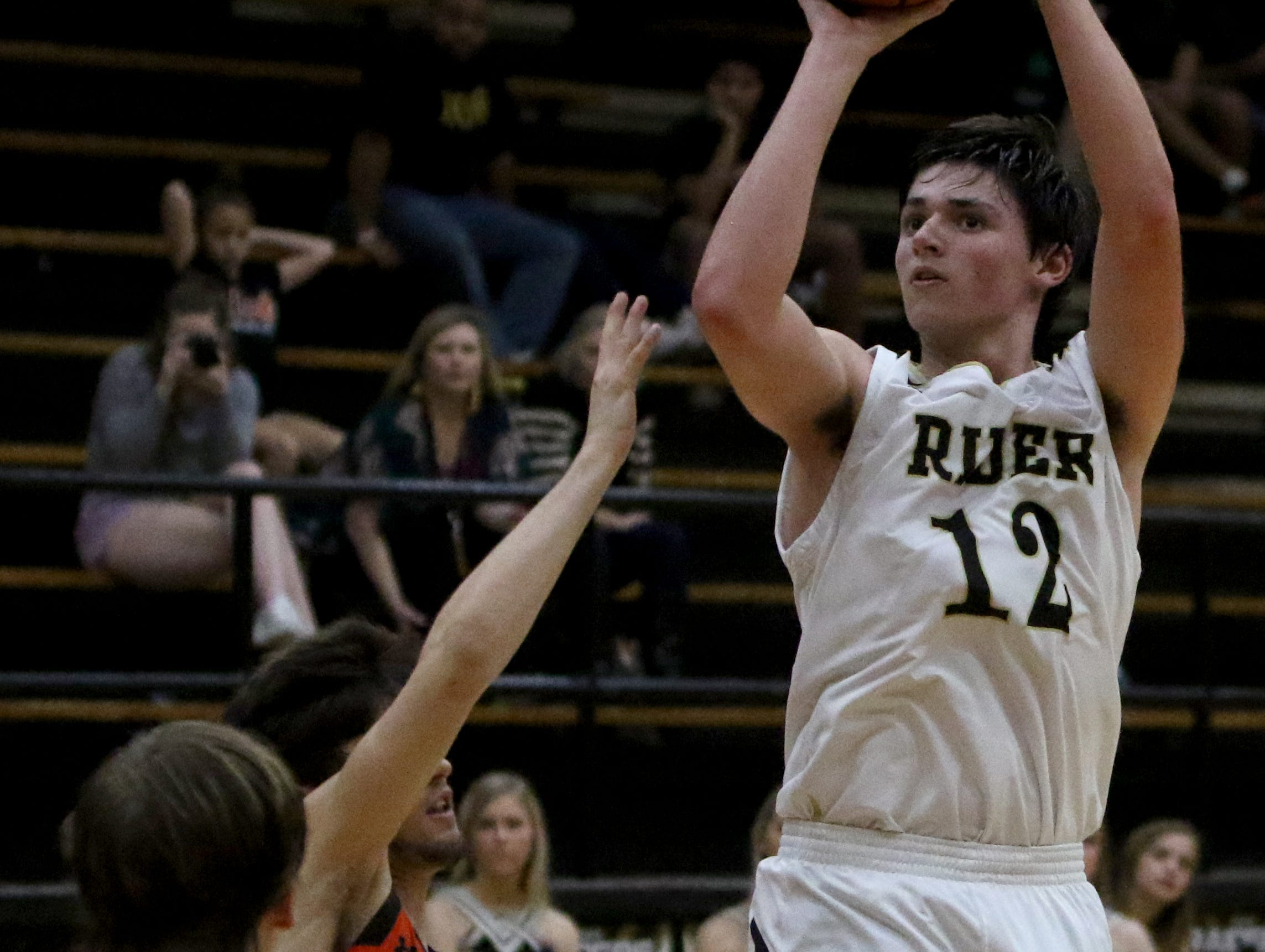 Rider's Ty Caswell shoots against Aledo Tuesday, Feb. 5, 2019, at Rider. The Raiders defeated the Bearcats 64-51.