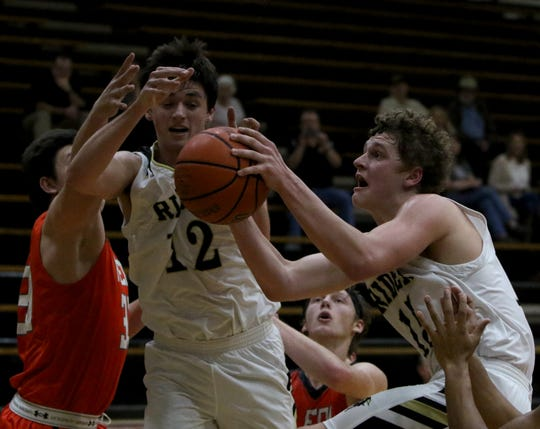Rider's Carson Sager grabs the rebound against Aledo Tuesday, Feb. 5, 2019, at Rider. The Raiders defeated the Bearcats 64-51.