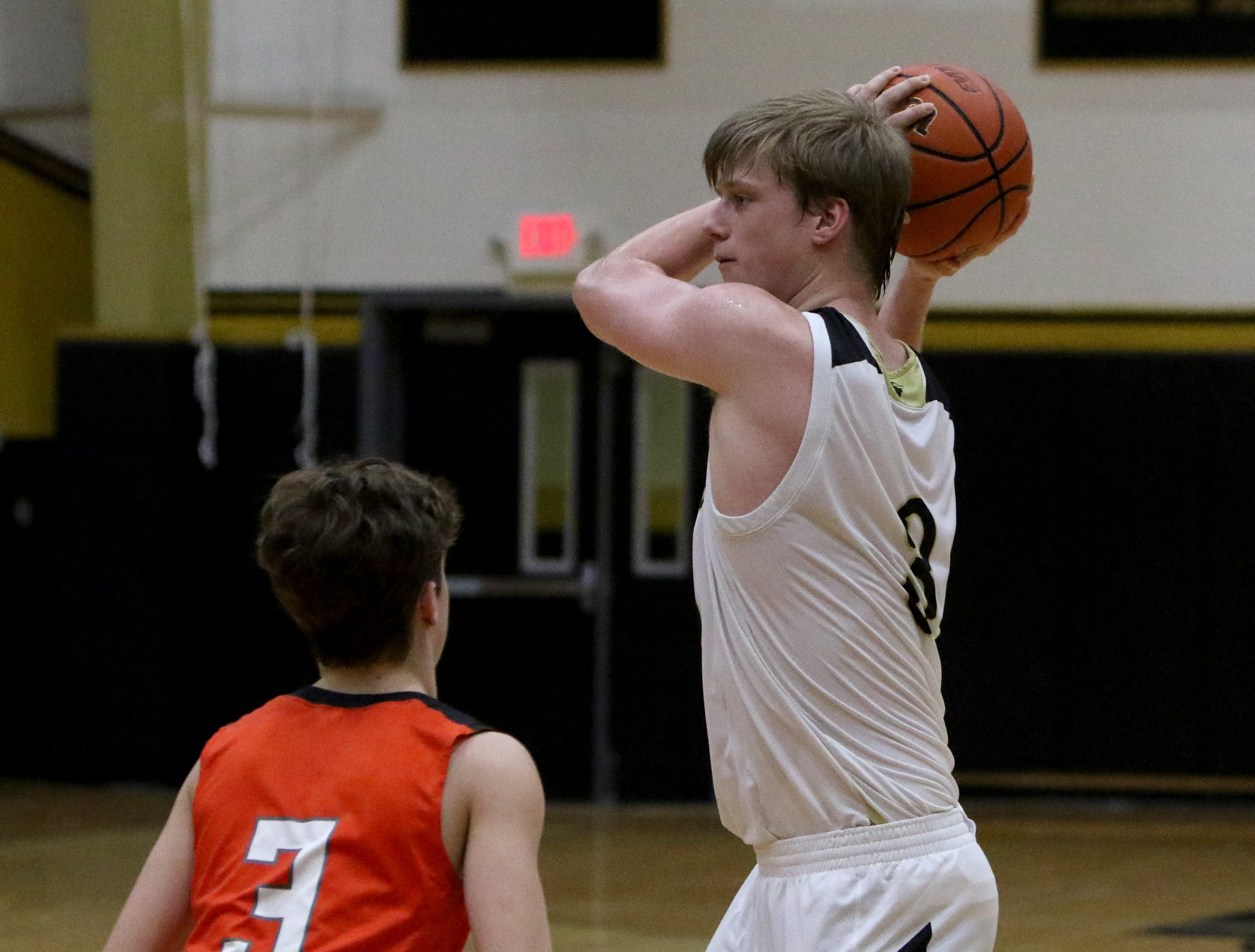 Rider's Ben Moffat looks to pass in the game against Aledo Tuesday, Feb. 5, 2019, at Rider. The Raiders defeated the Bearcats 64-51.