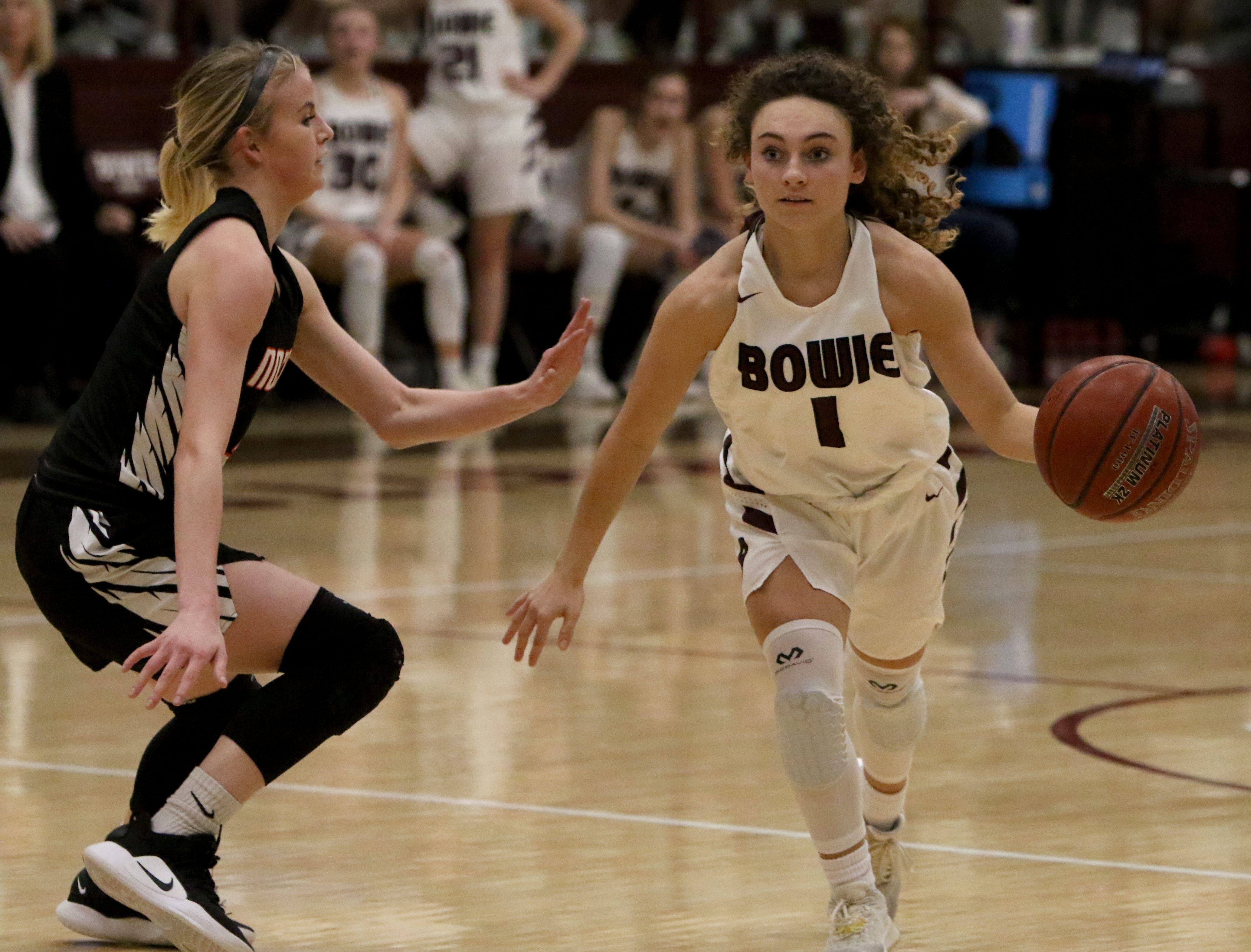 Bowie's Brysen Richey dribbles by Nocona's Chloe Daughtry Tuesday, Feb. 5, 2019, in Bowie. Nocona defeated Bowie 38-34.