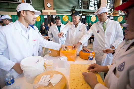 Judges examine entries during the 2017 US Cheese Championships in Green Bay, Wisconsin.  This year's entries are up 11 percent.