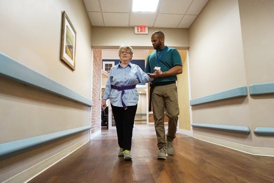 Physical Therapy Assistant Price Winston works with Connie Broadwater at Altercare in Zanesville. Broadwater's car was struck head-on by a  drunk driver in August. After multiple surgeries and driving determination on her part, Connie is learning to walk again.
