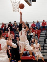 Junior Luken Hill goes up for a shot in the lane during Sheridan's 56-48 win against Philo on Tuesday night in suburban Thornville.