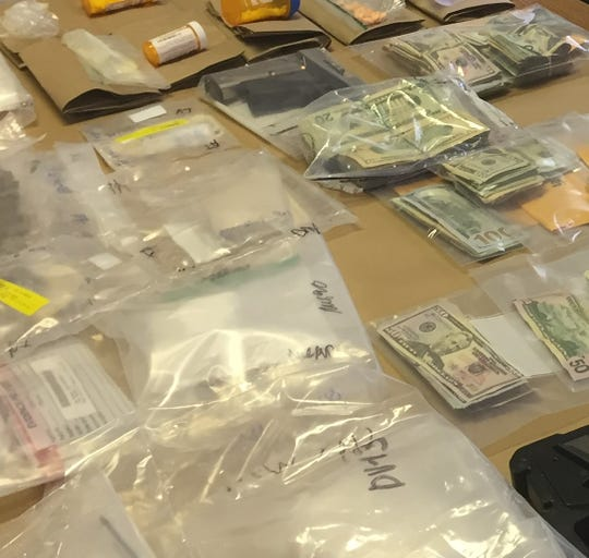 A drug raid in August resulted in the confiscation of  drugs, firearms, vehicles and about $60,000 in cash.