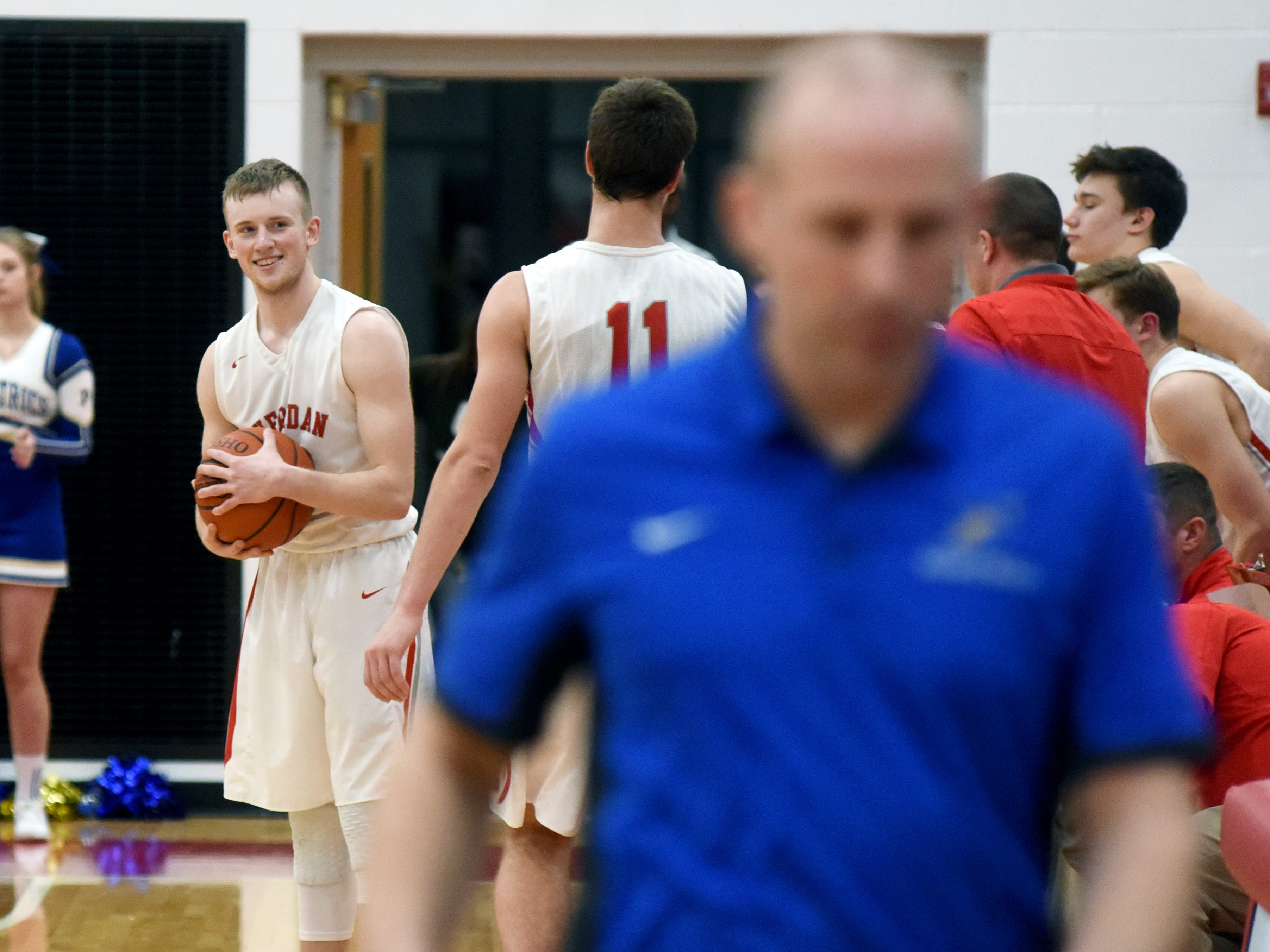 Philo coach Greg Haberfield, in the foreground, can only walk away in dismay after Sheridan's Landen Russell, left, and the Generals emerged with 56-48 win on Tuesday.