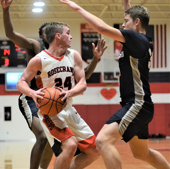 Rosecrans' Weston Nern is trapped by two Wellington defenders during Tuesday's 61-59 win. Nern scored a career-high 32 points for the Bishops.