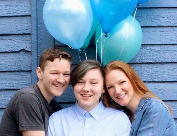 Lucas, Adrian and mom Heather Green embrace at Adrian's transgender coming out photo shoot.