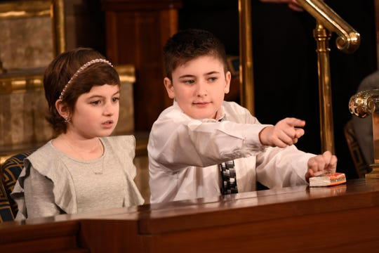 Guests in the First Lady's box, Grace Eline and Joshua Trump talk before President Donald Trump delivers the State of the Union address.