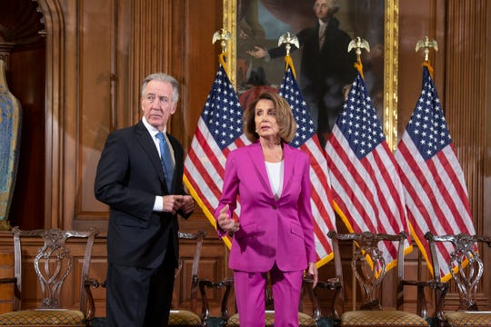 Speaker of the House Nancy Pelosi, D-Calif., center, with Ways and Means Committee Chair Richard Neal, D-Mass., left, waits for a formal photo session with new committee chairs, at the Capitol in Washington, Friday, Jan. 11, 2019.