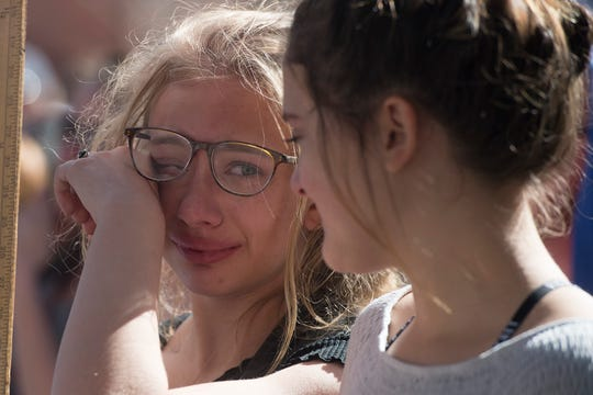 Bella Swanson, 13, wipes a tear away as she looks to her friend Bonnie Torres during a March for Our Lives event on on March 24, 2018. The gathering was a part of the national movement following the Parkland, Fla., shooting.